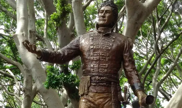 The toppling of statues overseas might give Australia pause to reconsider who we celebrate