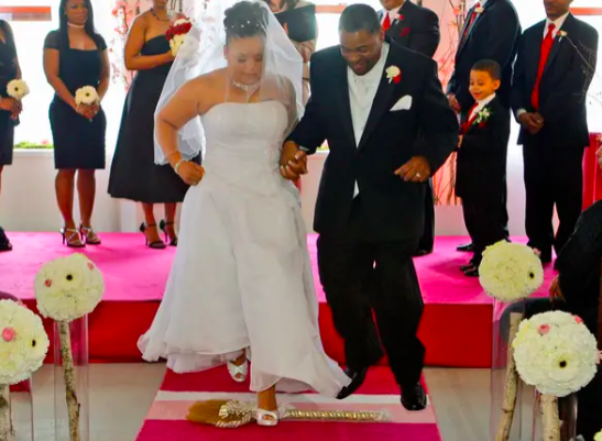 Here's the tangled history behind why some couples jump over a broom at their wedding